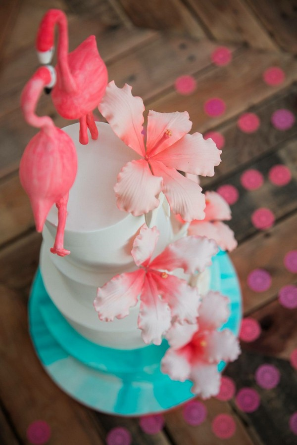 Wedding cake with pink flowers and flamingo topper, made by Claire's Sweet Temptations