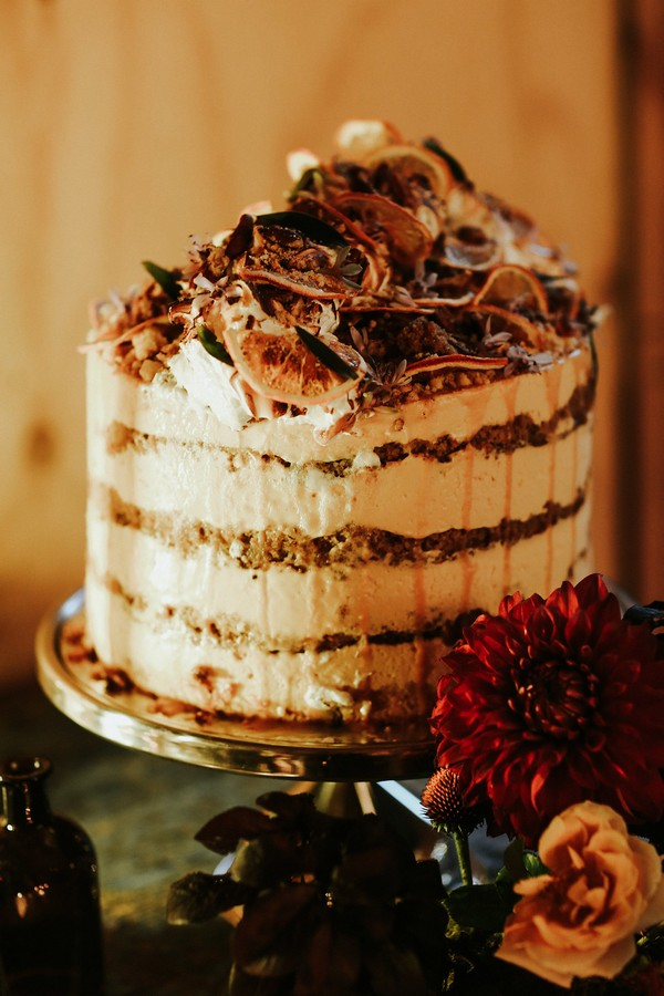 Cream layered wedding cake with orange slice top