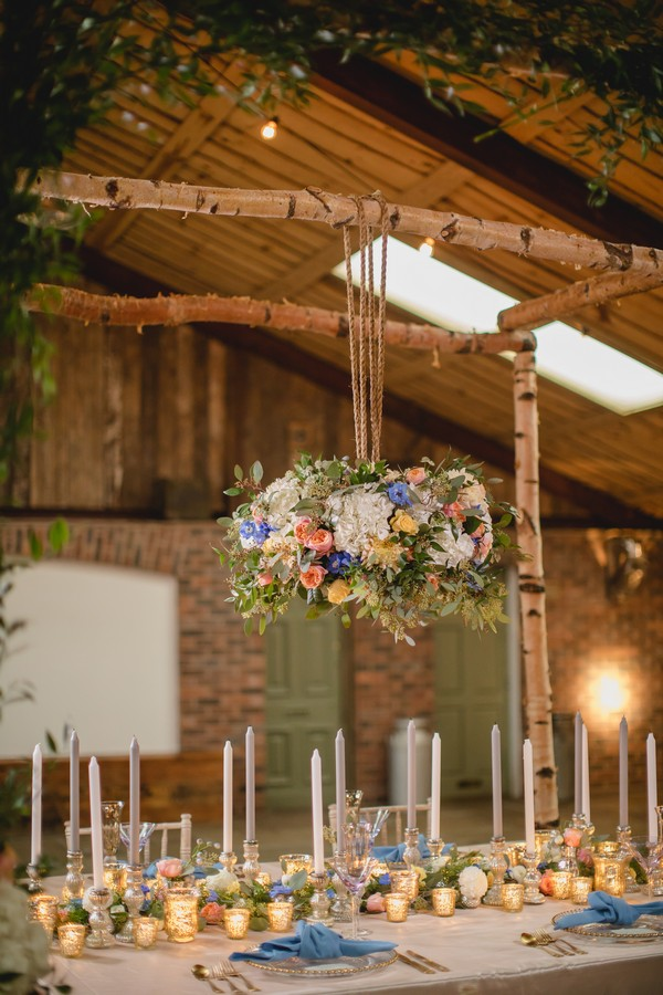 Hanging floral display above wedding table
