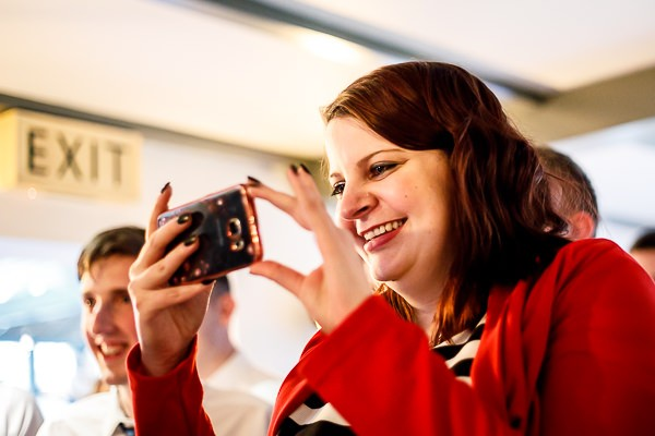Wedding guest taking picture on phone