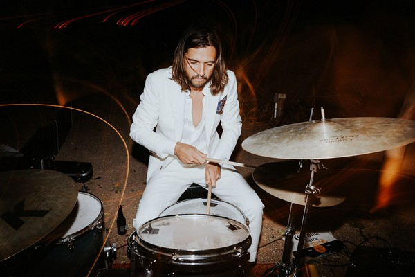 Groom playing drums