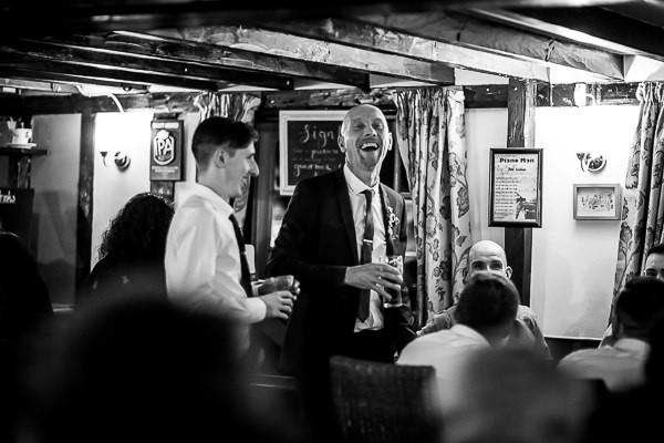 Groom laughing in pub