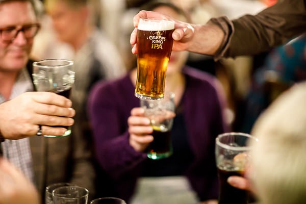 Toasting with pints in pub
