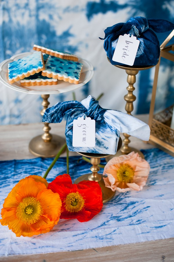 Bright flowers with gold and indigo blue wedding decorations
