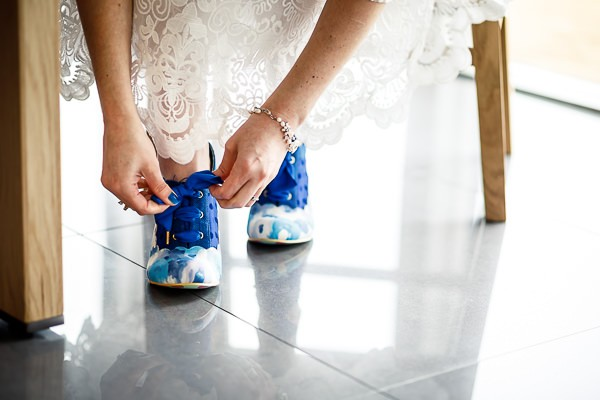 Bride doing up shoes