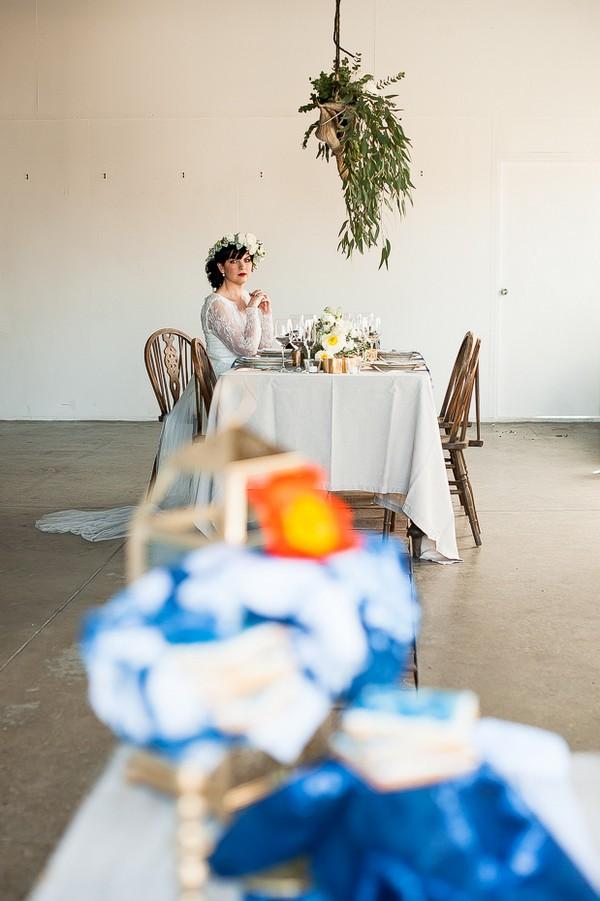 Bride sitting at wedding table
