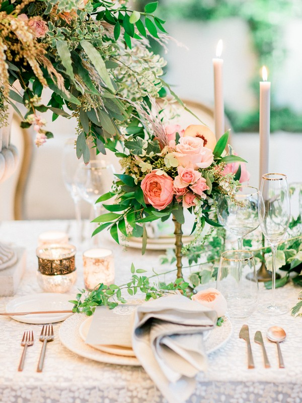 Wedding place setting with peach coloured flowers