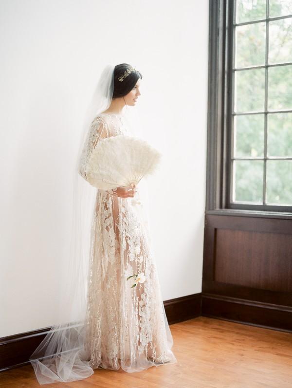 Bride holding fan