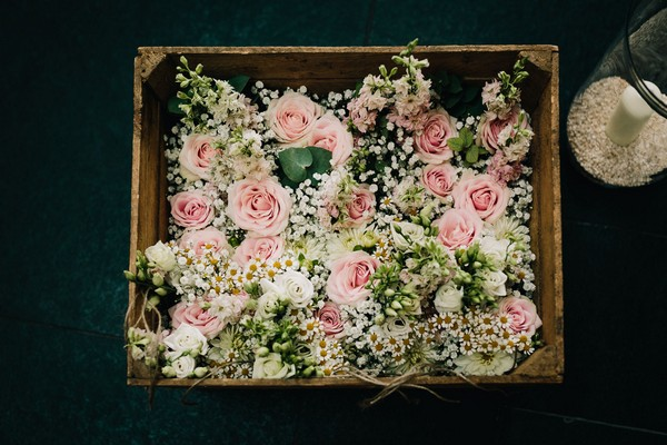 Box of pink wedding flowers