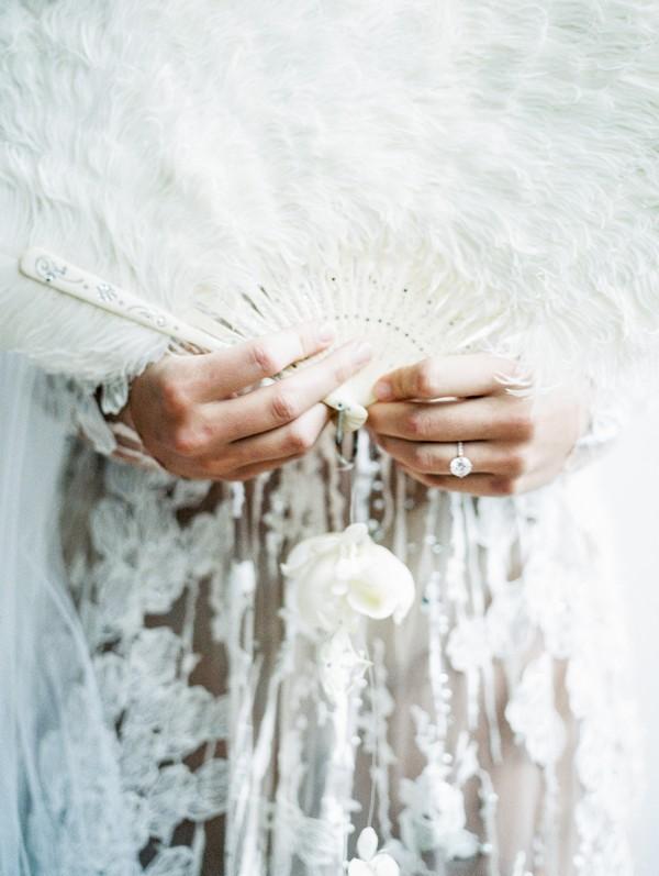 Feather fan in bride's hands
