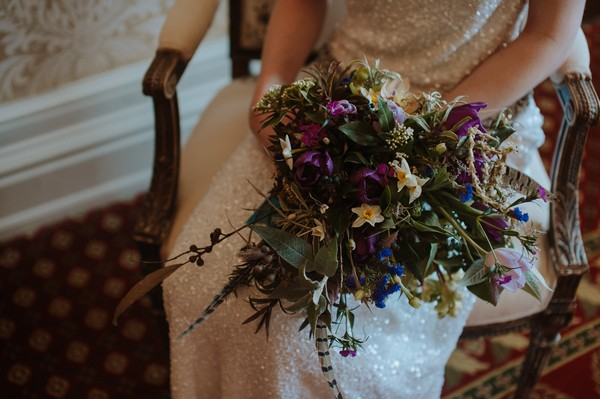 Bride's bouquet with dark flowers and foliage