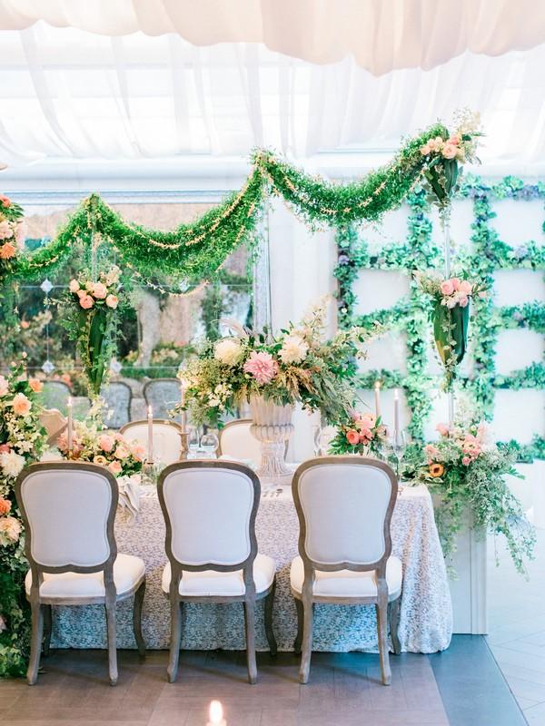 Foliage displays on and around wedding table