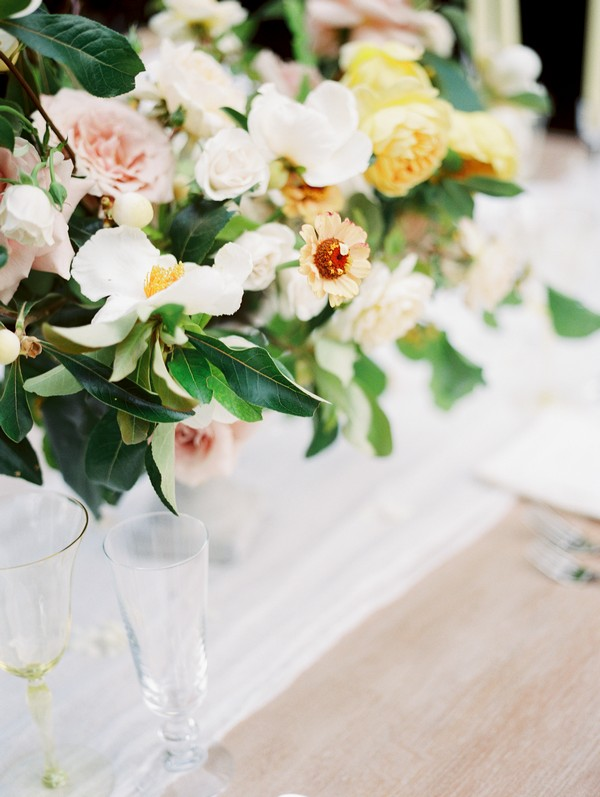 White and yellow wedding table flowers