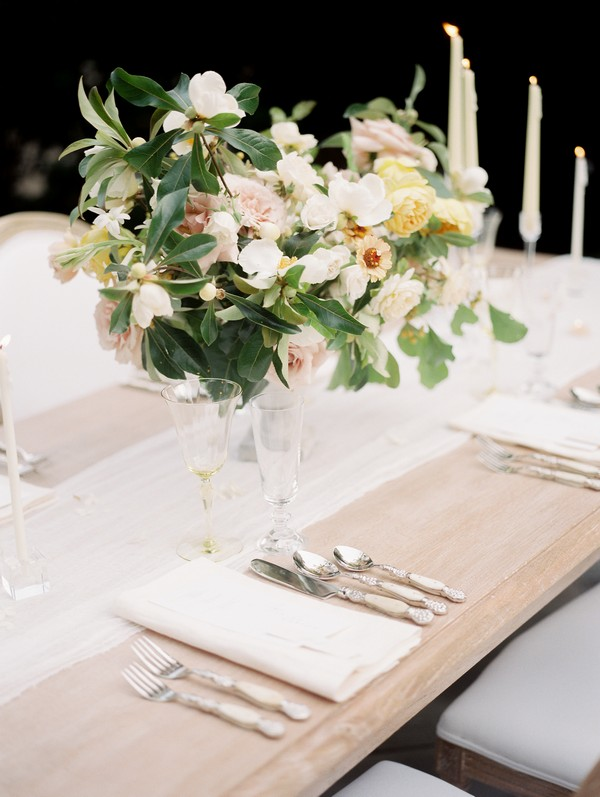 Vase of flowers on wedding table with simple, elegant styling