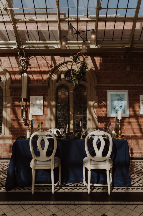 Small wedding table with dark styling