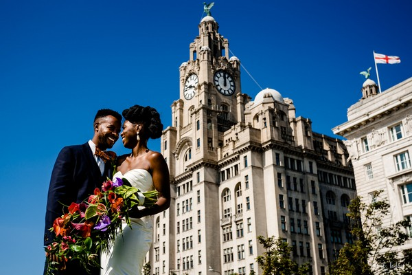 Bride and groom in front of the Royal Liver Building in Liverpool - Picture by About Today Photography