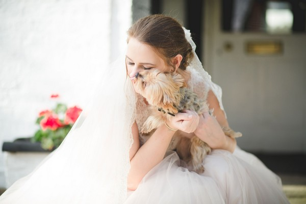 Bride cuddling small dog - Picture by Ella Parkinson Photography