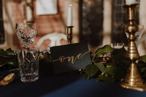 Dark blue hand lettering wedding table number