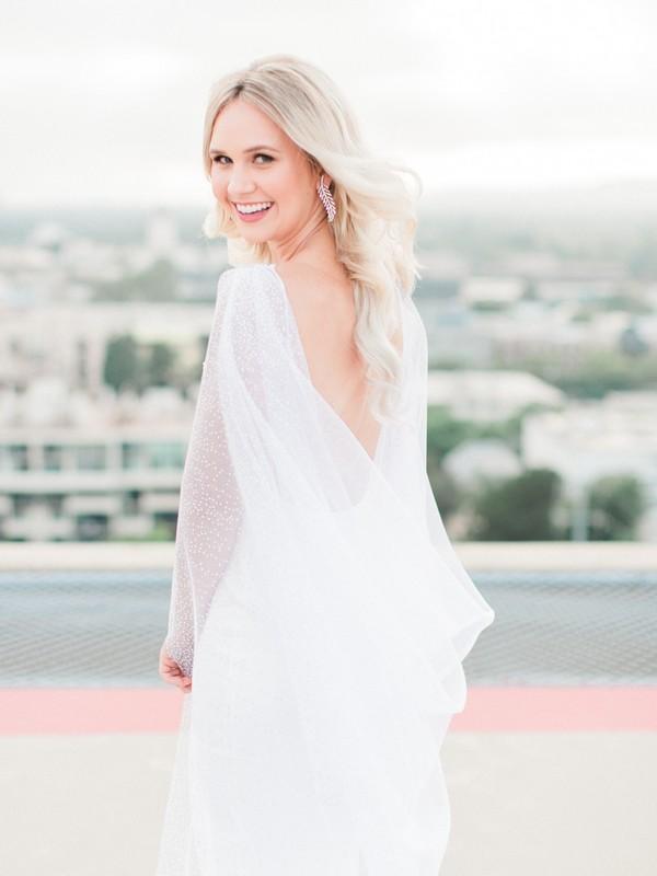 Bride wearing bridal cape