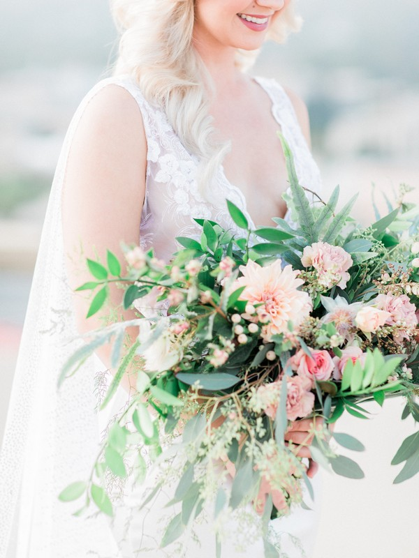 Bridal bouquet of foliage and peach flowers