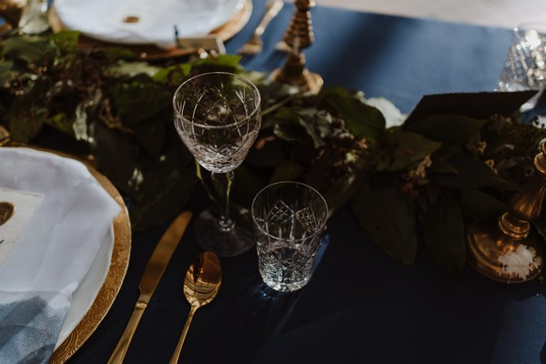 Glasses on wedding table with dark blue tablecloth