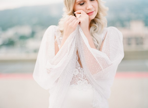 Bride with cape wrapped around her