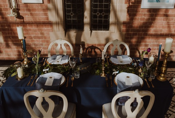 Small wedding table with dark blue tablecloth