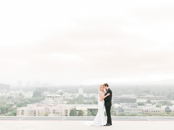 Bride and groom on roof of The Four Seasons in Beverly Hills