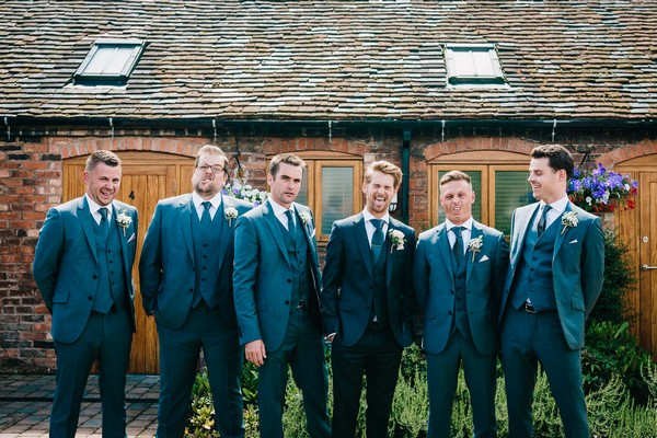 Groomsmen pulling silly faces