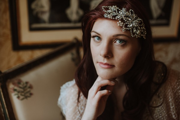 Bride wearing crystal and pearl hairpiece