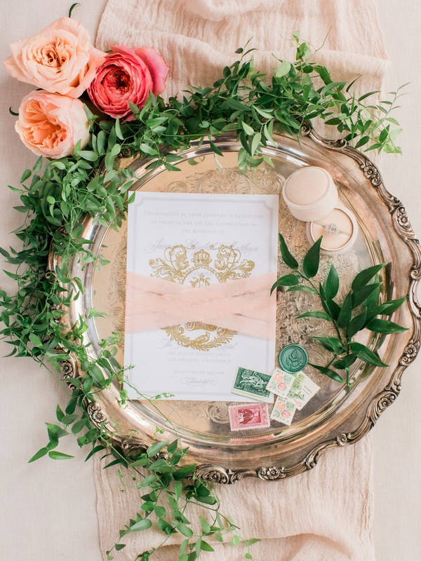Foliage around peach wedding stationery