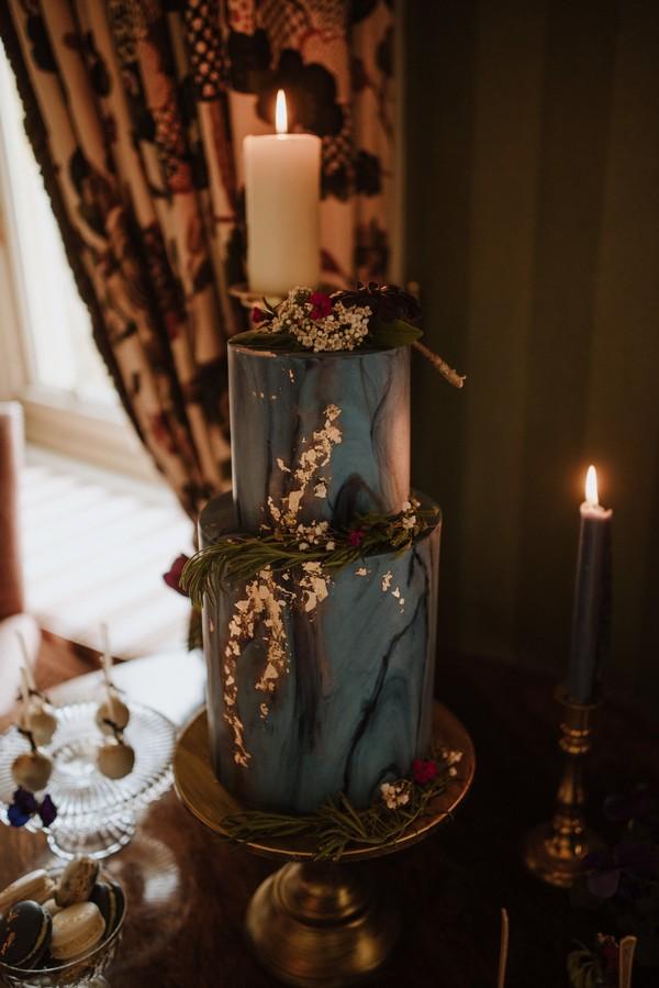 Dark blue wedding cake with gold leaf detail