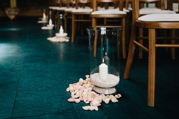 Candle in vase as wedding aisle decor