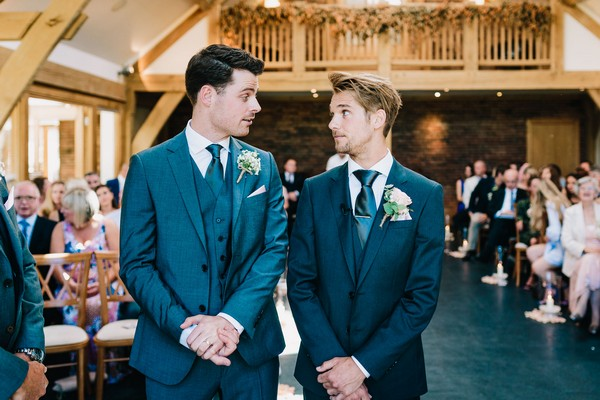 Groom and best man at altar