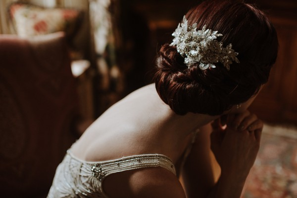 Hairpiece in back of bride's updo hairstyle