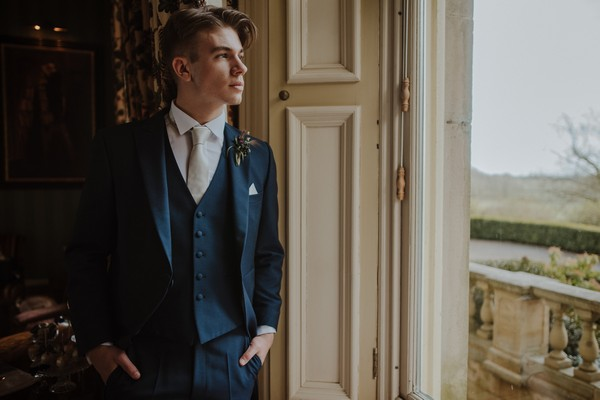 Groom looking out of window at Kilworth House