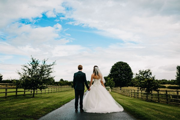 Bride and groom on driveway of Mythe Barn