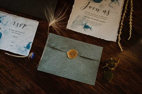 Blue envelope with gold wax seal