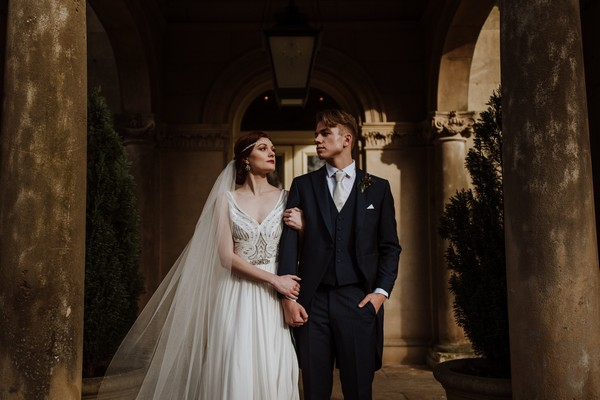 Bride and groom standing at entrance to Kilworth House