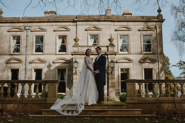 Bride and groom on steps of Kilworth House