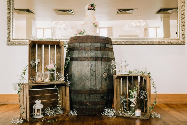 Wedding cake on barrel in middle of crates