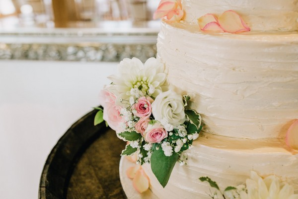 Pink and white flowers on wedding cake