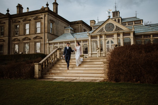 Bride and groom walking down steps outside Kilworth House