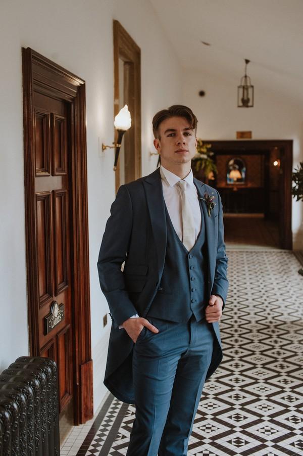 Groom wearing light blue suit
