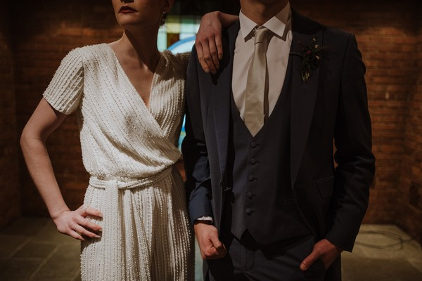 Detail on bride and groom's outfits