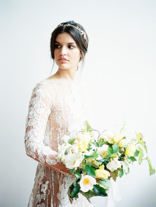 Bride holding yellow wedding bouquet
