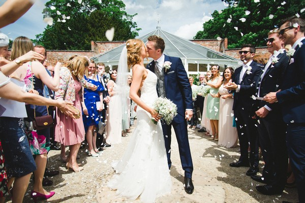 Bride and groom kissing after marrying at Combermere Abbey