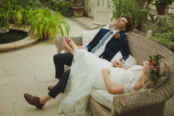 Bride and Groom Relaxing on a Couch