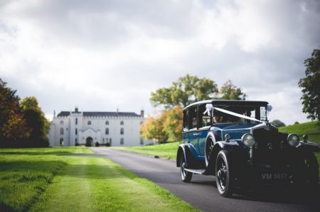 Classic car on drive of Combermere Abbey