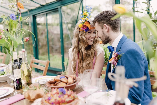 Boho bride and groom looking at each other